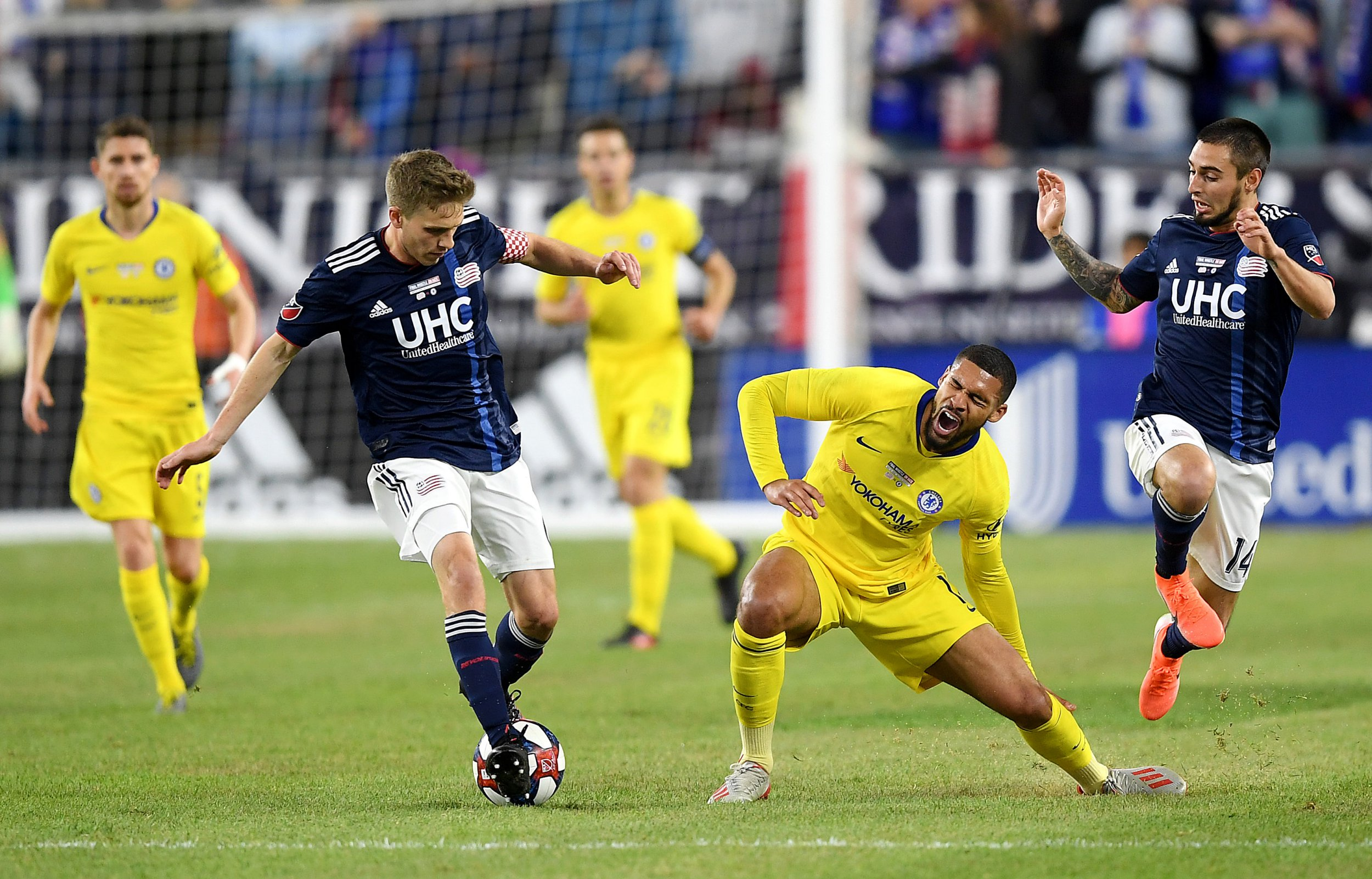 FOXBOROUGH, MASSACHUSETTS - MAY 15: Ruben Loftus-Cheek of Chelsea is challenged by Diego Fagundez of New England Revolution (R) during the Friendly Match match between New England Revolution and Chelsea at Gillette Stadium on May 15, 2019 in Foxborough, Massachusetts. (Photo by Darren Walsh/Chelsea FC via Getty Images)