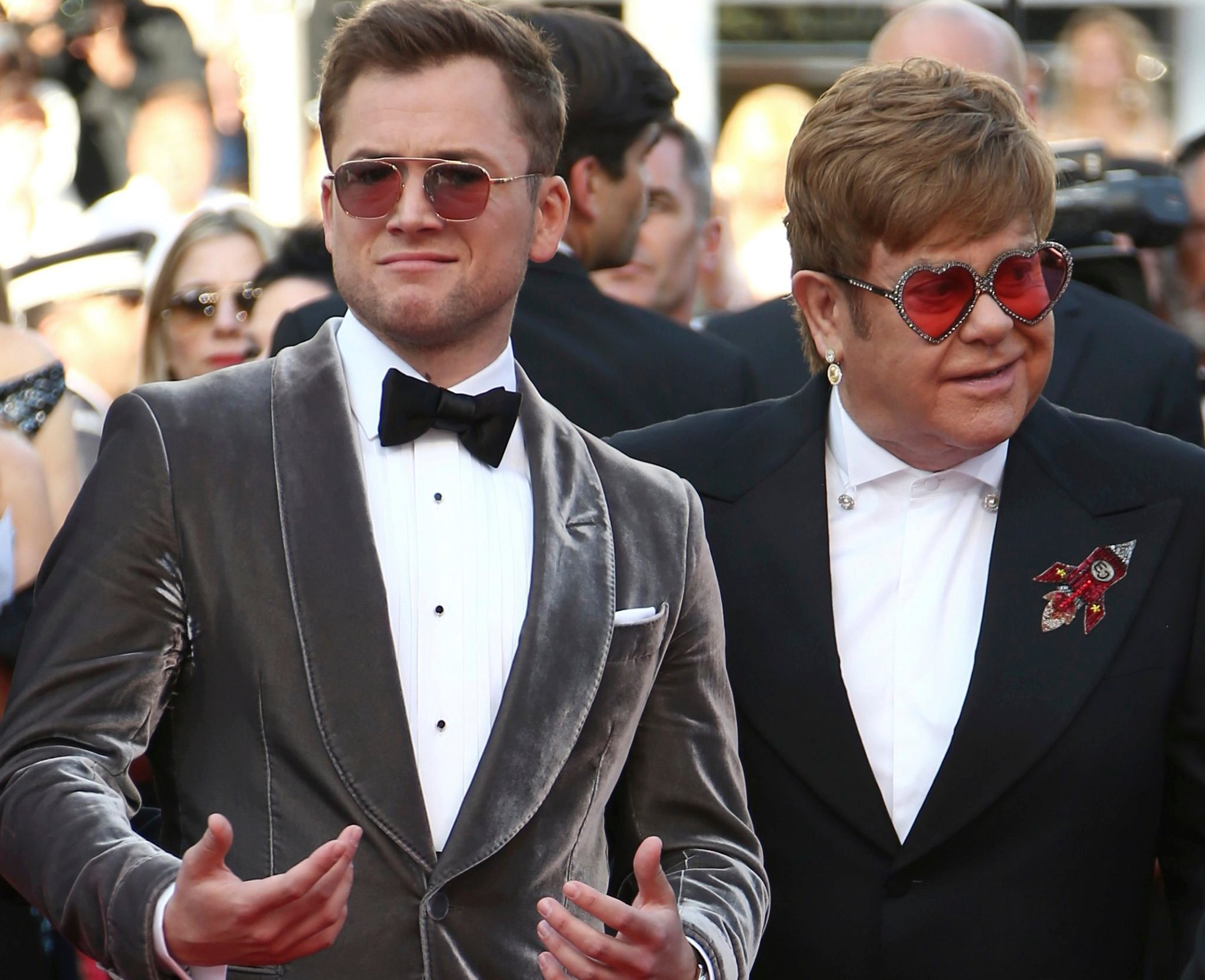 Taron Egerton and Elton John poise during a premiere of a film 'Rocketman' during Cannes
