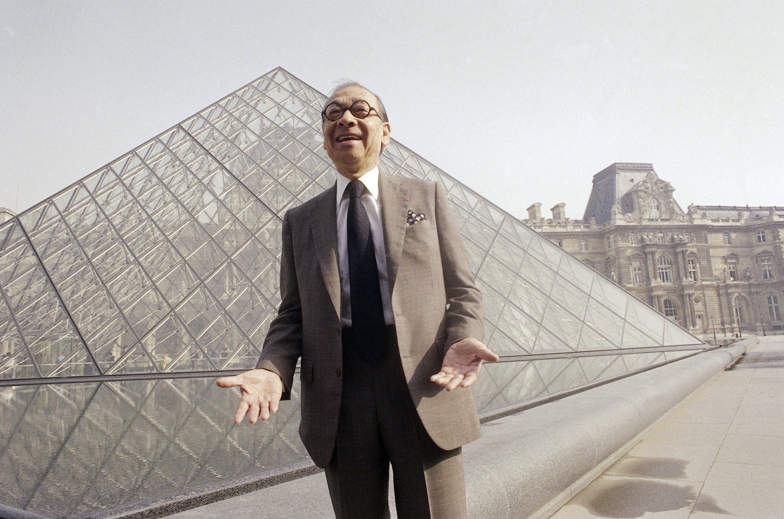 FILE - In this Mar 29, 1989, record photo, Chinese-American designer I.M. Pei laughs while posing for a mural in front of a Louvre potion pyramid, that he designed, in a museum's Napoleon Courtyard, before to a coronation in Paris. Pei, a globe-trotting designer who regenerated a Louvre museum in Paris with a hulk potion pyramid and prisoner a suggestion of rebellion during a multi-shaped Rock and Roll Hall of Fame, has died during age 102, a orator reliable Thursday, May 16, 2019. (AP Photo/Pierre Gleizes, File)