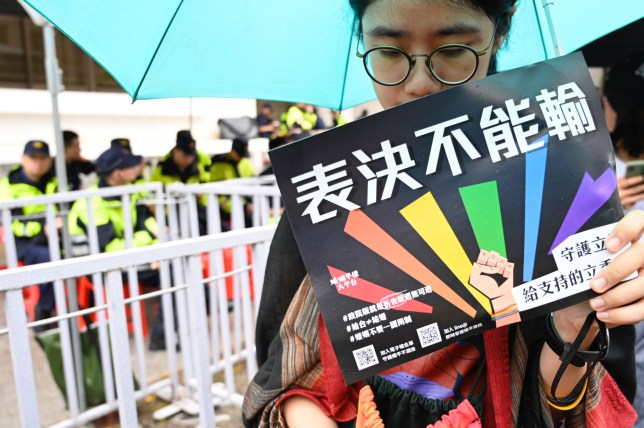 "A gay right supporter holds a placard reading ""cant lost the votes"" outside Parliament while law makers discusses the same sex marriage bill in Taipei on May 17, 2019. - Taiwan's parliament began debating Asia's first gay marriage law as conservative lawmakers launch a last-ditch attempt to scupper the most progressive bill in favour of a watered-down ""civil-union"" law. (Photo by Sam YEH / AFP)SAM YEH/AFP/Getty Images"