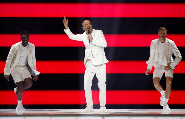 "Serhat of San Marino, center, performs the song ""Say Na Na Na"" during the 2019 Eurovision Song Contest grand final in Tel Aviv, Israel, Saturday, May 18, 2019. (AP Photo/Sebastian Scheiner)"