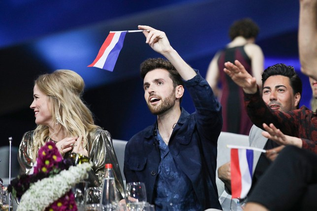 Duncan Laurence, winner of the 2019 Eurovision Song Contest, flying the flag of the Netherlands