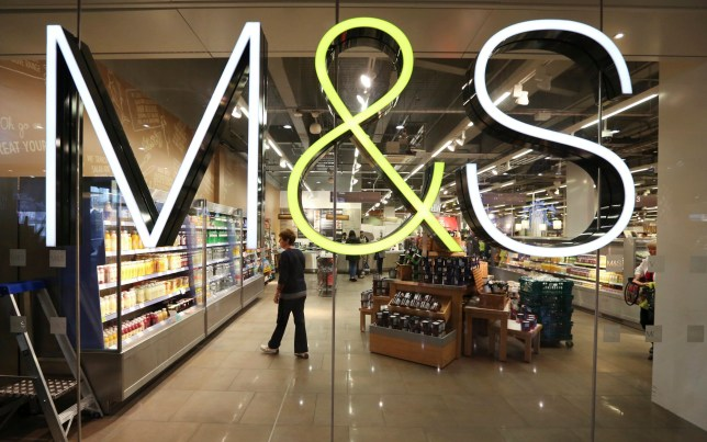 The M&S company logo in the window of a shop
