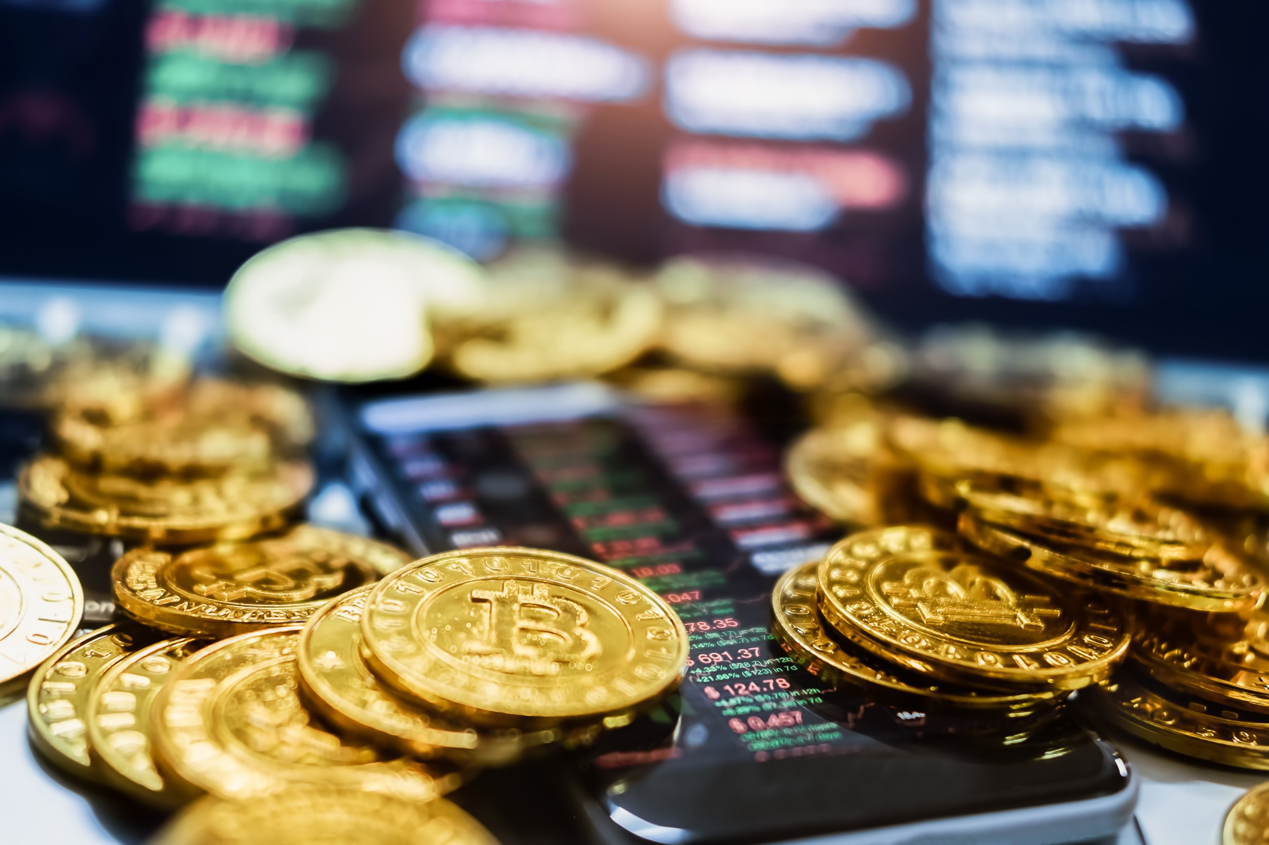 Picture of coins representing digital cryptocurrency bitcoin that runs controlling blockchain technology