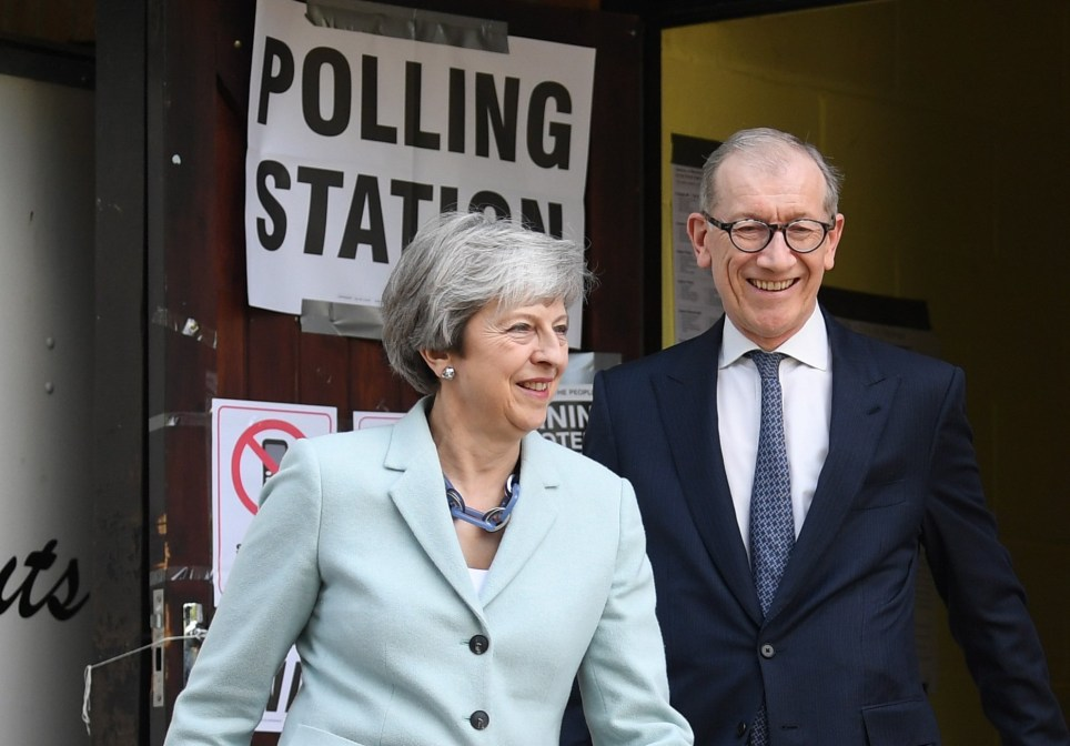 epa07594604 Britain's Prime Minster Theresa May (L) and her husband Phillip (R) cast their vote at a polling station during the European elections in her Maidenhead constituency in Britain, 23 May 2019. The European Parliament election is held by member countries of the European Union (EU) from 23 to 26 May 2019. EPA/NEIL HALL