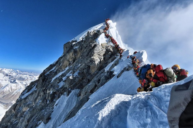 "(FILES) In this file handout photo taken on May 22, 2019 and released by climber Nirmal Purja's Project Possible expedition shows heavy traffic of mountain climbers lining up to stand at the summit of Mount Everest. - Three more climbers have died on Everest, expedition organisers and officials said on May 24, taking the toll from a deadly week on the overcrowded world's highest peak to seven. (Photo by Handout / Project Possible / AFP) / RESTRICTED TO EDITORIAL USE - MANDATORY CREDIT ""AFP PHOTO / PROJECT POSSIBLE"" - NO MARKETING NO ADVERTISING CAMPAIGNS - DISTRIBUTED AS A SERVICE TO CLIENTS ---HANDOUT/AFP/Getty Images"