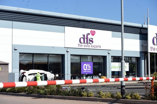Two men in critical condition after crashing into DFS store