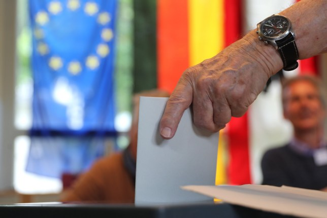 A man casts his vote in the European elections in Berlin, Germany