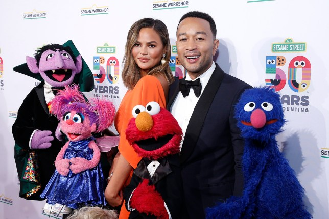 Chrissy Teigen and John Legend attend Sesame Workshop's 50th Anniversary Benefit Gala at Cipriani Wall Street in New York City
