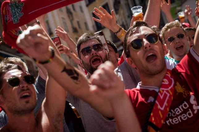 Liverpool fans shout slogans as they march in downtown Madrid, Spain, Friday, May 31, 2019, ahead of the Champions League soccer final on Saturday. Madrid will be hosting the final again after nearly a decade, but the country's streak of having at least one team playing for the European title ended this year after five straight seasons, giving home fans little to cheer for when Liverpool faces Tottenham at the Wanda Metropolitano Stadium on Saturday. (AP Photo/Emilio Morenatti)