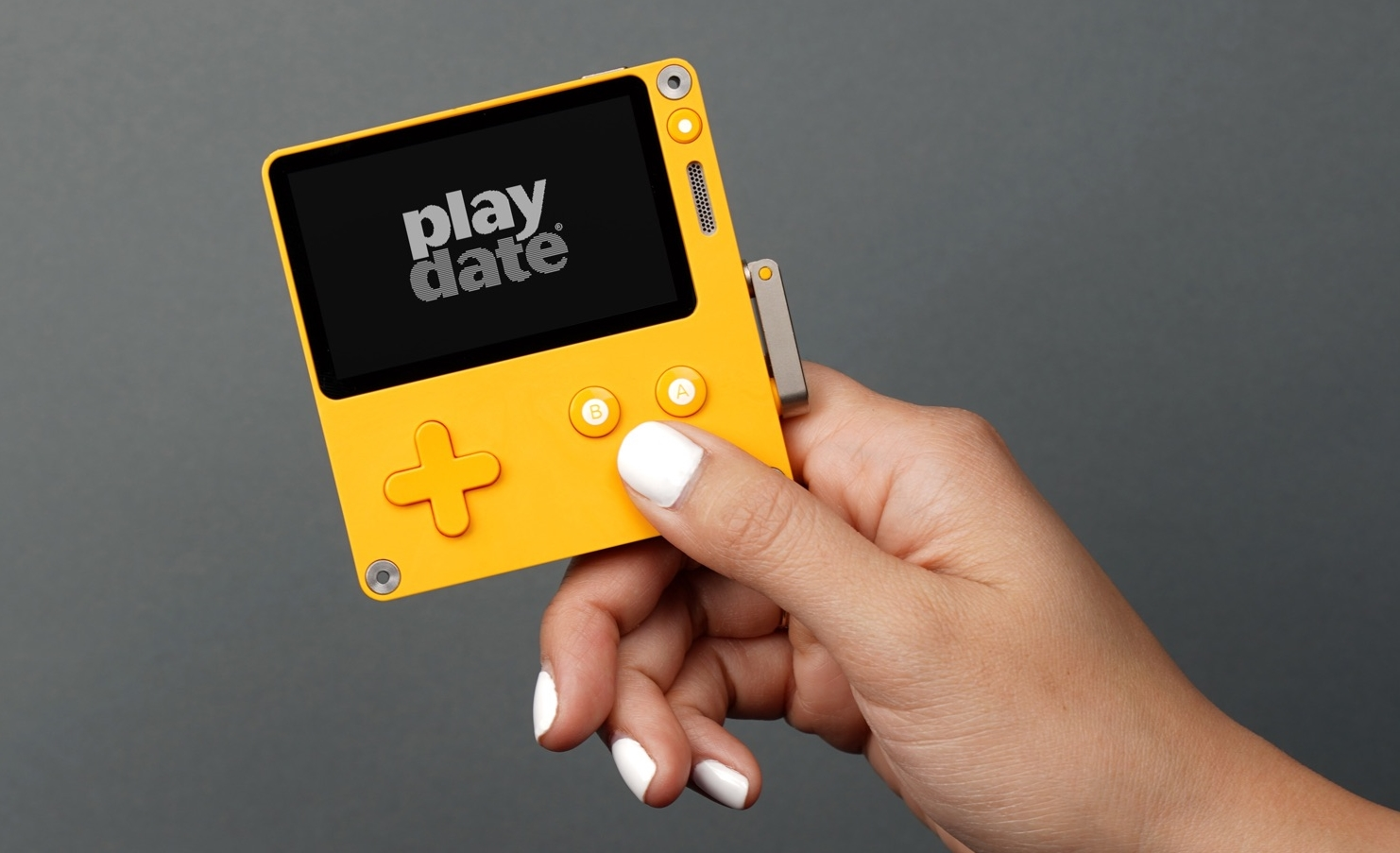 Playdate is a black & white handheld console with a crank controller