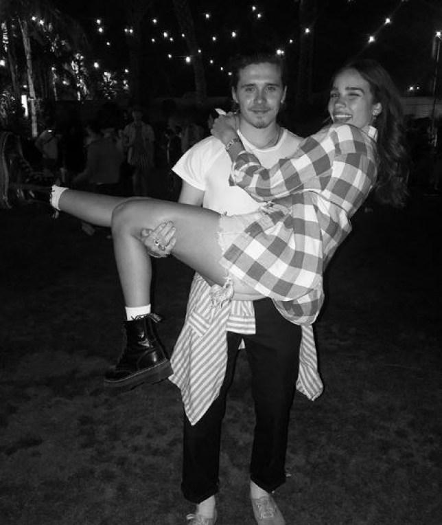 Brooklyn Beckham holding Hana Cross