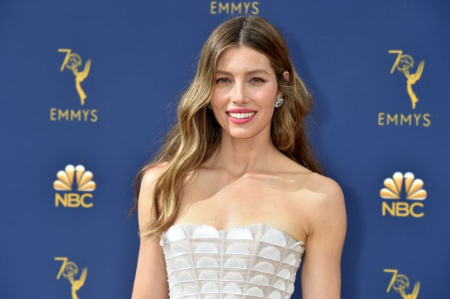 Jessica Biel posing in a white dress at the Emmy Awards