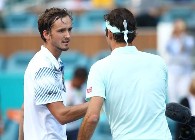 Daniil Medvedev shakes hands with Roger Federer