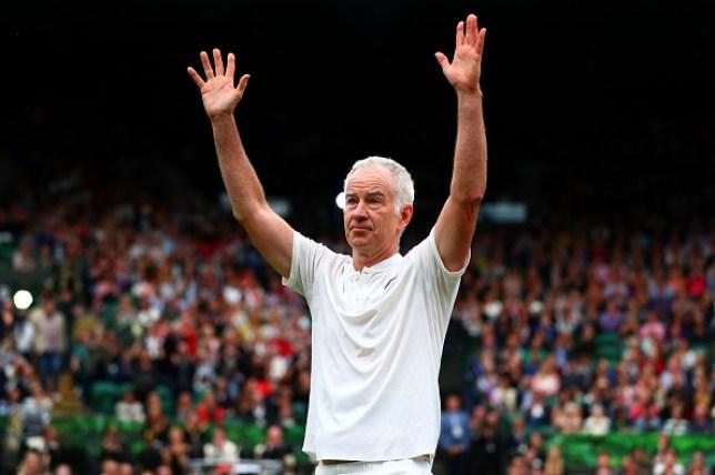 John McEnroe celebrates with the Wimbledon crowd