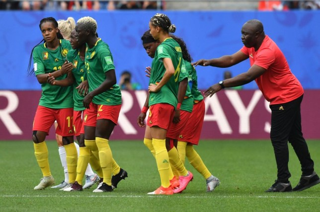 Cameroon manager Alain Djeumfa and his players