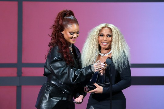 Mary J Blige accepting BET Lifetime Achievement Award from Rihanna