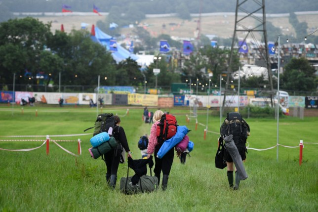 Festival goers arrive as the gates open during day one of Glastonbury Festival at Worthy Farm