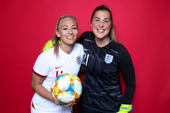 Toni Duggan and Mary Earps wearing England kits and holding a football with red background