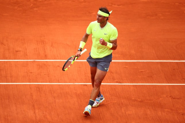 Rafael Nadal celebrates on his way to a 12th French Open title