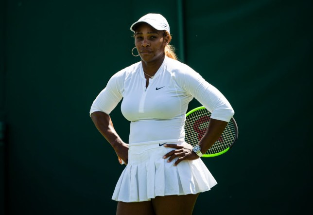 Serena Williams stands hands on hips at Wimbledon