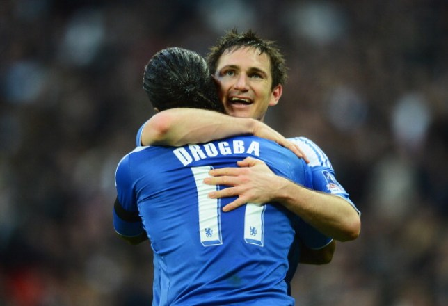 Frank Lampard hugging Chelsea team-mate Didier Drogba