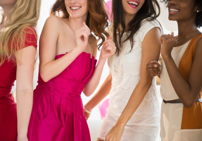 Women dancing together at party