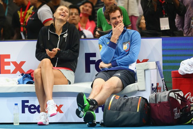 Maria Sharapova and Andy Murray sit on the sidelines laughing when playing doubles together