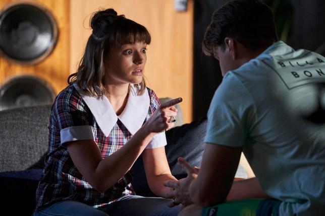 Bella (Courtney Miller) and Colby (Tim Franklin) talk