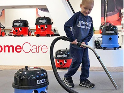 Boy with leukaemia travels 4,000 miles to visit Henry the Hoover factory