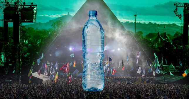 Plastic water bottle in front of Glastonbury festival crowd at Pyramid stage