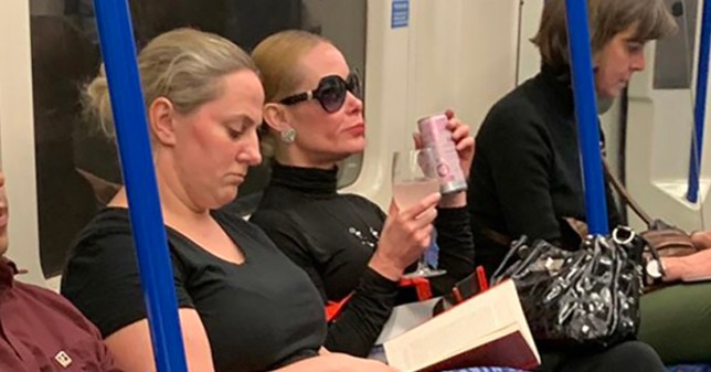 Woman drinking pink gin from wine glass on Tube is instantly iconicTAKEN WITHOUT PERMISSION