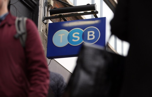 A TSB logo sits on a sign as it hangs outside a TSB bank branch, operated by TSB Banking Group Plc, in London, U.K., on Friday, March 20, 2015. Banco de Sabadell SA, Spain's fifth-biggest bank, will sell 1.6 billion euros ($1.7 billion) of new shares to fund its takeover of Britain's TSB Banking Group. Photographer: Chris Ratcliffe/Bloomberg via Getty Images
