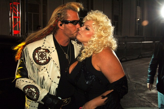 Duane Dog Chapman and Beth Smith kiss on red carpet