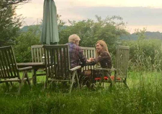 Boris and Carrie are seen together for first time since police row as friends dismiss rumours of split and insist 'they are very much in love and want to get married as soon as time is right' Boris Johnson, 55, and girlfriend Carrie Symonds, 31, have fled their home after activists set up camp outside But the couple have been pictured holding hands and smiling at a table in the Sussex countryside yesterday A friend said: 'The truth is they love each other very much and want to get married as soon as the time is right' A recording of them having an explosive row inside their south London love nest has dented his PM hopes Since then 'class war' anarchists have descended on his flat saying Boris isn't welcome in Camberwell Now the couple cannot return home and have moved to a secret UK location as he fights to become next PM Jacob Rees-Mogg called the couple who called police and recorded the row 'Corbynista curtain twitchers'