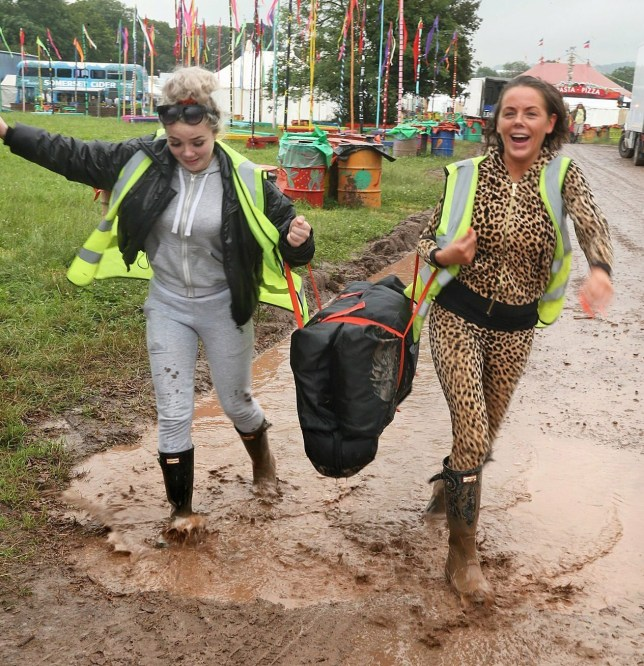 Parts of the Glastonbury Festival site are already laden with mud after heavy overnight rain - as these two early arrivals discovered