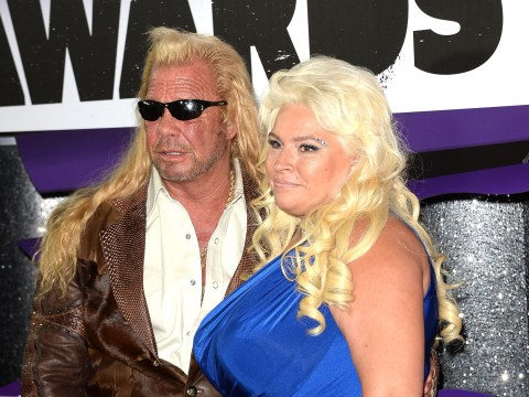 Dog The Bounty Hunter places a pillow where his late wife Beth lay in bed