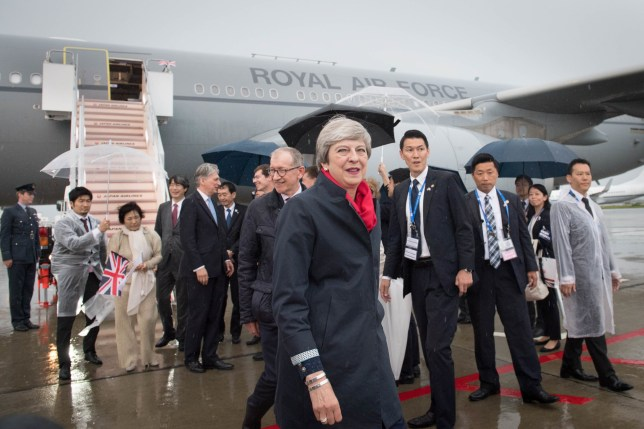 Prime Minister Theresa May walks from her aircraft with her husband, Philip, and the Chancellor, Philip Hammond (background), after arriving at Osaka in Japan for the G20 summit. PRESS ASSOCIATION Photo. Picture date: Thursday June 27, 2019. See PA story POLITICS G20. Photo credit should read: Stefan Rousseau/PA Wire