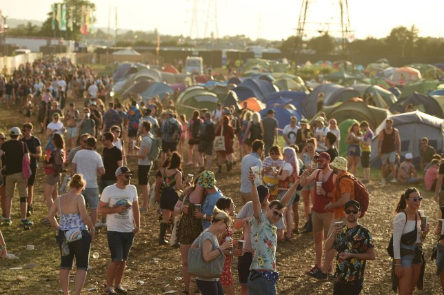 Revellers attend the 2019 Glastonbury Festival of Music and Performing Arts