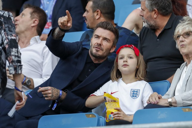 LE HAVRE, FRANCE - JUNE 27: David Beckham and his daughter Harper Beckham enjoy the atmosphere during the 2019 FIFA Women's World Cup France Quarter Final match between Norway and England at Stade Oceane on June 27, 2019 in Le Havre, France. (Photo by Catherine Steenkeste/Getty Images)