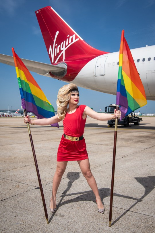 EDITORIAL USE ONLY Drag Queen DJ Jodie Harsh ahead of the Virgin Atlantic and Virgin Holidays Pride Flight, at Heathrow Airport, London. PRESS ASSOCIATION Photo. Picture date: Friday June 28, 2019. The one-of-a-kind flight is celebrating World Pride in New York City and will be filled with exclusive entertainment from Jodie Harsh and Tituss Burgess as well as other surprises. The flight is staffed by LGBT+ crew members demonstrating Virgin???s commitment to celebrating diversity in all its shapes and forms. Photo credit should read: Matt Crossick/PA Wire