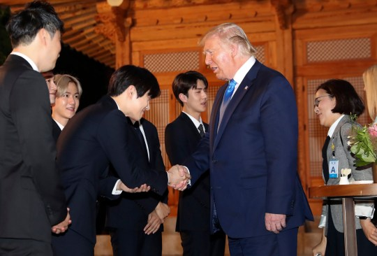 epa07682578 US President Donald J. Trump (C-R) shakes hands with a member of South Korean boy group EXO during his visit to the South Korean presidential office Cheong Wa Dae in Seoul, South Korea, 29 June 2019, to attend a welcome dinner hosted by President Moon Jae-in. Trump is on a two-day visit to South Korea with a potential trip planned to the Demilitarized Zone (DMZ) that divides the two Koreas. EPA/YONHAP SOUTH KOREA OUT