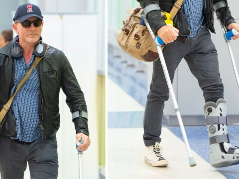 Daniel Craig sports crutches and cast in first appearance since surgery as James Bond filming pushed back