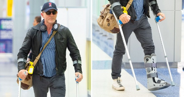 Daniel Craig on crutches