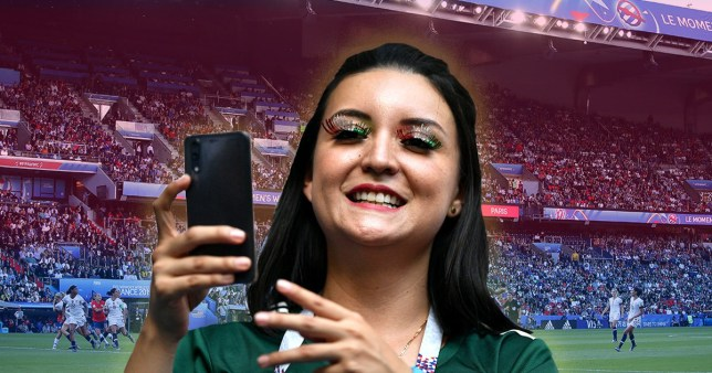 Woman in sports jersey taking a picture
