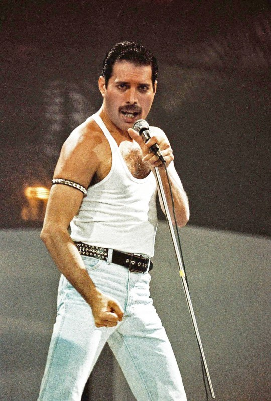 Freddie Mercury of Queen performs on stage at Live Aid on July 13th, 1985