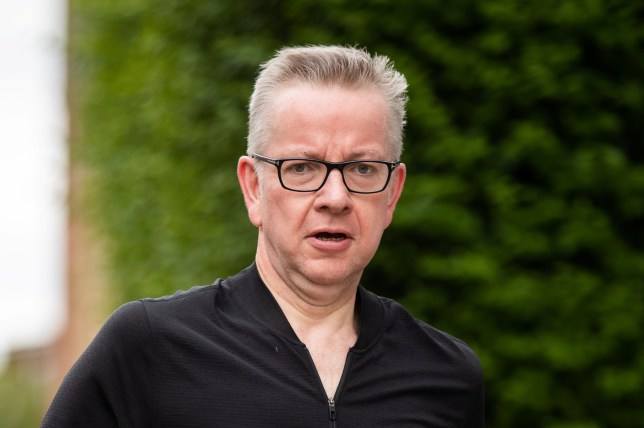 Michael Gove runs back to his West London home