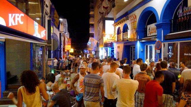 Part revellers outside KFC in Ibiza's San Antonio
