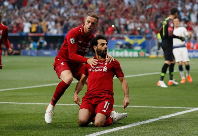 Mohamed Salah of Liverpool slides on his knees to celebrate scoring the first goal from the penalty spot with Jordan Henderson of Liverpool during the UEFA Champions League match at Wanda Metropolitano Stadium, Madrid. Picture date: 1st June 2019. Picture credit should read: David Klein/Sportimage