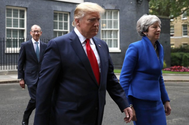 Donald Trump and UK Prime Minister Theresa May pictured last month. Trump has launched another attack on May, branding her 'foolish' and criticizing what he claims is her 'failure' to properly negotiate Britain's upcoming departure from the European Union